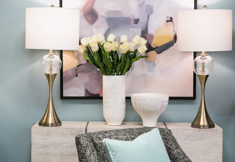 two lamps, vase of tulips and decorative bowl